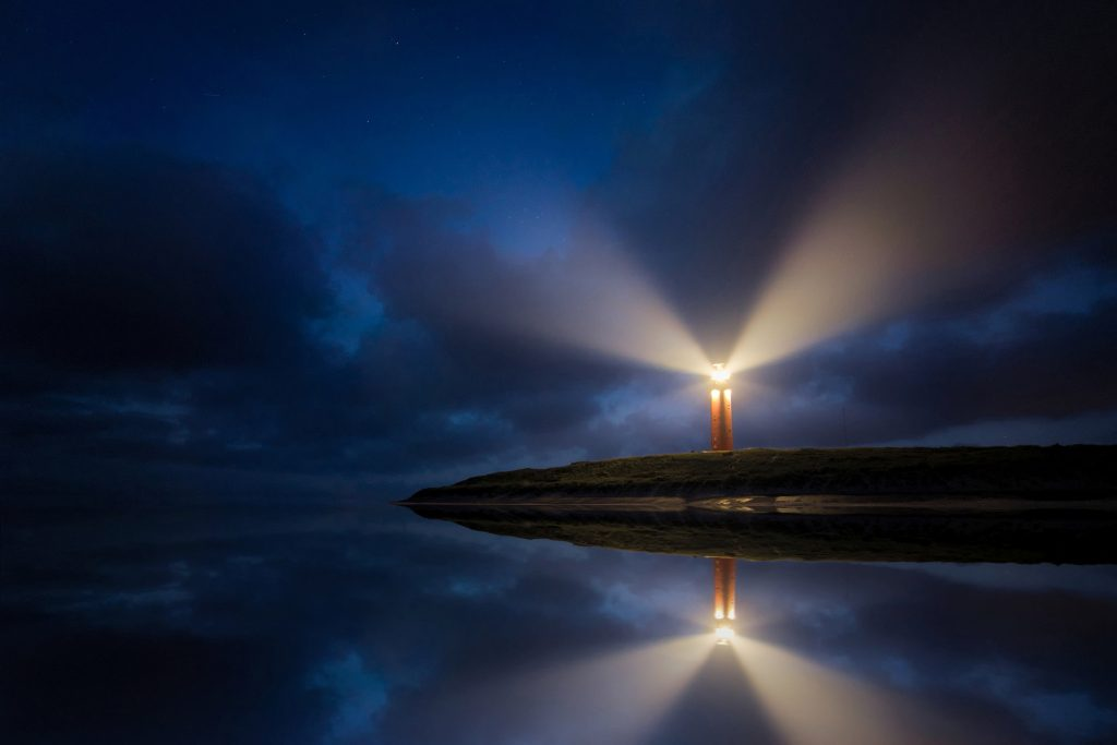 Image of a lighthouse in the dark