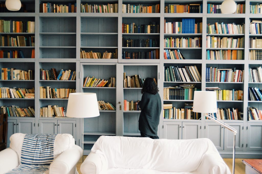 Image of woman looking at empty bookshelves